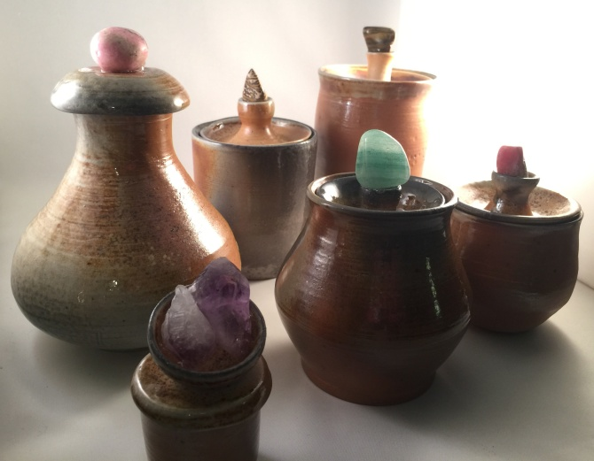 hand-crafted pottery with crystals and stones